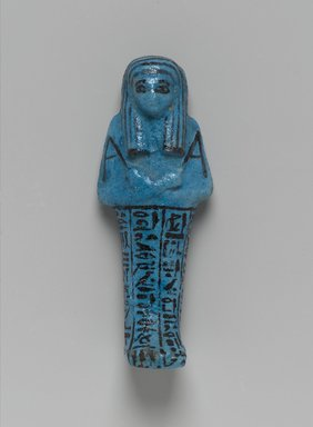 Shabty of Nesi-ta-nebet-Isheru, Daughter of Pinedjem II, ca. 1075-945 B.C.E. Faience, glazed, 5 13/16 x 2 1/4 x 1 1/2 in. (14.7 x 5.7 x 3.8 cm). Brooklyn Museum, Gift of Evangeline Wilbour Blashfield, Theodora Wilbour, and Victor Wilbour honoring the wishes of their mother, Charlotte Beebe Wilbour, as a memorial to their father, Charles Edwin Wilbour, 16.183. Creative Commons-BY