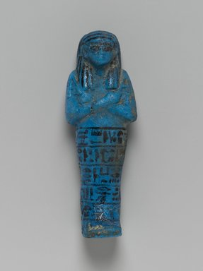 Shabty of the Princess Nesi-Khonsu, ca. 1075-945 B.C.E. Faience, glazed, 6 1/4 x 2 1/4 x 1 1/2 in. (15.9 x 5.7 x 3.8 cm). Brooklyn Museum, Gift of Evangeline Wilbour Blashfield, Theodora Wilbour, and Victor Wilbour honoring the wishes of their mother, Charlotte Beebe Wilbour, as a memorial to their father, Charles Edwin Wilbour, 16.185. Creative Commons-BY