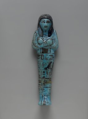 Shabty of Riya, ca. 1292-1075 B.C.E. Faience, 7 1/16 x 2 1/8 x 1 3/8 in. (18 x 5.4 x 3.5 cm). Brooklyn Museum, Gift of Evangeline Wilbour Blashfield, Theodora Wilbour, and Victor Wilbour honoring the wishes of their mother, Charlotte Beebe Wilbour, as a memorial to their father, Charles Edwin Wilbour, 16.192. Creative Commons-BY