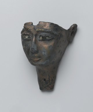 Face from a Composite Statue, 1075-656 B.C. Bronze, 1 5/8 x 2 1/16 x 2 13/16 in. (4.1 x 5.3 x 7.2 cm). Brooklyn Museum, Gift of Evangeline Wilbour Blashfield, Theodora Wilbour, and Victor Wilbour honoring the wishes of their mother, Charlotte Beebe Wilbour, as a memorial to their father, Charles Edwin Wilbour, 16.198. Creative Commons-BY