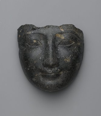 Face from a Sarcophagus Cover, ca. 1539-1292 B.C.E. Granite, 5 13/16 x 6 1/8 in. (14.8 x 15.5 cm). Brooklyn Museum, Gift of Evangeline Wilbour Blashfield, Theodora Wilbour, and Victor Wilbour honoring the wishes of their mother, Charlotte Beebe Wilbour, as a memorial to their father, Charles Edwin Wilbour, 16.207. Creative Commons-BY