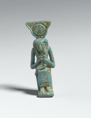 Figure of Isis Holding Horus. Faience, 1 9/16 x 9/16 in. (3.9 x 1.5 cm). Brooklyn Museum, Gift of Evangeline Wilbour Blashfield, Theodora Wilbour, and Victor Wilbour honoring the wishes of their mother, Charlotte Beebe Wilbour, as a memorial to their father, Charles Edwin Wilbour, 16.425. Creative Commons-BY