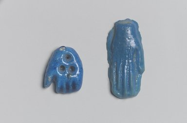 Open Right Hand as Amulet. Faience, 11/16 x 1 9/16 in. (1.7 x 4 cm). Brooklyn Museum, Gift of Evangeline Wilbour Blashfield, Theodora Wilbour, and Victor Wilbour honoring the wishes of their mother, Charlotte Beebe Wilbour, as a memorial to their father Charles Edwin Wilbour, 16.580.35. Creative Commons-BY