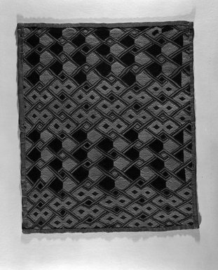 Kuba (Shoowa subgroup). Raffia Cloth Panel Marked K307, 20th century. Raffia, 22 7/8 x 19 5/16 in. (58.0 x 49.0 cm). Brooklyn Museum, Gift of The Roebling Society, 1989.11.7. Creative Commons-BY