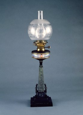 "J. Holgate & Company. ""Cleopatra's Needle"" Table Lamp, ca. 1877. Black patinated bronze, porcelain, brass, glass, 29 1/2 x 6 3/4 x 6 3/4 in. Brooklyn Museum, Gift of Isabel Shults, by exchange, 1989.114a-d. Creative Commons-BY"