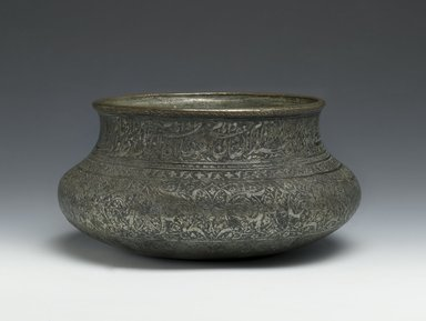 Wine Bowl Inscribed with the Names of the Twelve Shi`a Imams, late 16th-early 17th century. Copper; cast, raised, and turned, then tinned; engraved and inlaid, H: 3 1/2 in. (8.9 cm). Brooklyn Museum, Gift of Mrs. Charles K. Wilkinson in memory of her husband, 1989.149.4. Creative Commons-BY