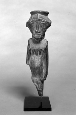 "Buyu. Standing Figure, 19th or 20th century. Wood, pigment ""accretion"", 16 1/2 x 4 3/4 x 5 in. (41.9 x 12.1 x 12.8 cm). Brooklyn Museum, Gift of Drs. John I. and Nicole Dintenfass, 1989.173.1. Creative Commons-BY"