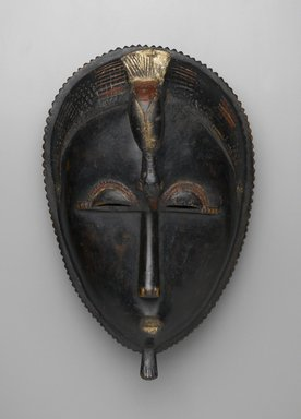 Baule. Mblo Portrait Mask, late 19th-early 20th century. Wood, pigment, 13 3/8 x 8 7/16 x 6 1/8 in. (34 x 21.5 x 15.5 cm). Brooklyn Museum, The Adolph and Esther D. Gottlieb Collection, 1989.51.15. Creative Commons-BY