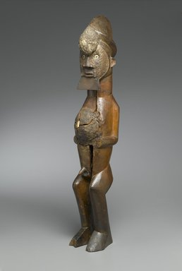 Master of Mayama. Figure of Standing Male (Nkisi), late 19th century. Wood, shell, mud, metal, resin, organic materials, imported buttons, 25 1/2 x 4 1/4 x 4 3/4 in. (64.8 x 10.8 x 12.1 cm). Brooklyn Museum, The Adolph and Esther D. Gottlieb Collection, 1989.51.19. Creative Commons-BY