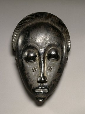 Baule. Mblo Portrait Mask, late 19th or early 20th century. Wood, oils, pigment, 10 1/2 x 5 3/8 x 3 in.(26.7 x 13.7 x 7.6 cm). Brooklyn Museum, The Adolph and Esther D. Gottlieb Collection, 1989.51.25. Creative Commons-BY