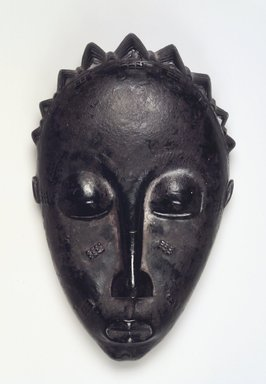 Baule. Mblo Portrait Mask, late 19th or early 20th century. Wood, oils, pigment, ferrous nails, 8 3/4 x 5 1/4 x 2 1/2 in. (22.2 x 13.3 x 6.4 cm). Brooklyn Museum, The Adolph and Esther D. Gottlieb Collection, 1989.51.27. Creative Commons-BY