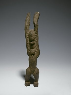 Dogon. Nommo Figure with Raised Arms, 11th-15th century (possibly). Wood, organic sacrificial materials, 10 1/2 x 2 7/8 x 1 3/4 in. (26.7 x 7.3 x 4.4 cm). Brooklyn Museum, The Adolph and Esther D. Gottlieb Collection, 1989.51.39. Creative Commons-BY