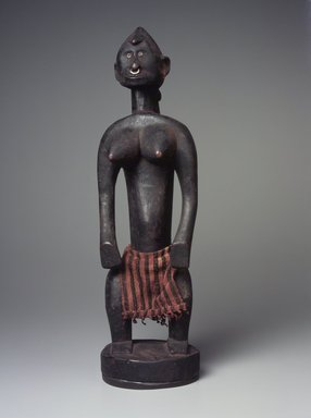 Bamana. Figure of a Standing Female (Nyeleni), 20th century. Wood, metal, cloth, 16 3/4 x 5 1/4 x 5 1/2 in. (42.5 x 13.3 14 cm). Brooklyn Museum, The Adolph and Esther D. Gottlieb Collection, 1989.51.4. Creative Commons-BY