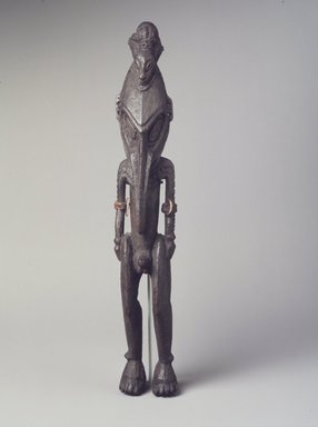 Figure, 20th century. Wood, shell, fiber, 14 x 2 1/4 x 2 1/4 in. (35.6 x 5.7 x 5.7 cm). Brooklyn Museum, The Adolph and Esther D. Gottlieb Collection, 1989.51.42. Creative Commons-BY