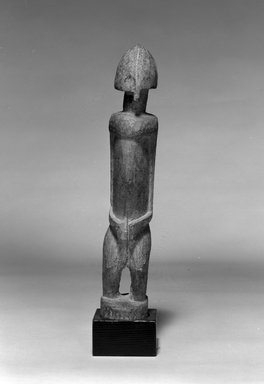 Dogon. Standing Figure with Helmet-Shaped Head, late 19th or early 20th century. Wood, 11 3/4 x 2 1/8 x 2 3/8 in. (29.8 x 5.4 x 6 cm). Brooklyn Museum, The Adolph and Esther D. Gottlieb Collection, 1989.51.48. Creative Commons-BY