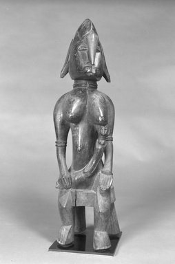 Senufo. Figure of a Seated Mother and Child, 20th century. Wood, 25 x 7 x 8 in. (63.5 x 17.8 x 20.3 cm). Brooklyn Museum, The Adolph and Esther D. Gottlieb Collection, 1989.51.50. Creative Commons-BY