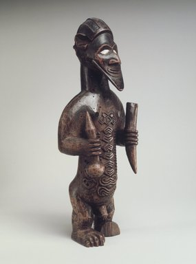 Kongo (Beembe subgroup). Male Figure (Bimbi), 19th century. Wood, shell, 5 3/4 x 2 1/8 x 1 1/2in. (14.6 x 5.4 x 3.8cm). Brooklyn Museum, The Adolph and Esther D. Gottlieb Collection, 1989.51.56. Creative Commons-BY