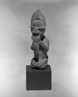Yoruba. Kneeling Figure Blowing Whistle, late 19th or early 20th century. Wood, pigment, sacrificial patina, 8 1/16 x 2 1/2 x 2 1/2 in. Brooklyn Museum, The Adolph and Esther D. Gottlieb Collection, 1989.51.59. Creative Commons-BY