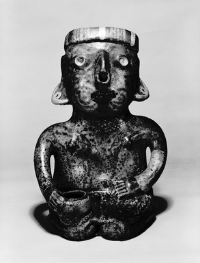 Nayarit. Seated Male Figure, 300 B.C.E.- 200 C.E. Ceramic, pigment, 14 x 9 1/4 x 8 in. (35.6 x 23.5 x 20.3 cm). Brooklyn Museum, The Adolph and Esther D. Gottlieb Collection, 1989.51.66. Creative Commons-BY