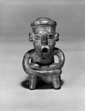 Protoclassic. Seated Figurine. Clay, pigment, 5 1/2 x 3 1/4 x 3 1/4 in. (14 x 8.3 x 8.3 cm). Brooklyn Museum, The Adolph and Esther D. Gottlieb Collection, 1989.51.67. Creative Commons-BY