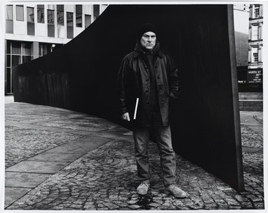 "Arthur Mones (American, 1919-1998). Richard Serra beside His ""Tilted Arc,"" 1988. Gelatin silver photograph, Sheet: 16 x 20 in. Brooklyn Museum, Gift of the artist, 1990.118. © Estate of Arthur Mones"