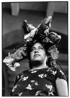 Graciela Iturbide (Mexican, born 1942). Nuestra Señora de las Iguanas (Our Lady of the Iguanas), Juchitán, Oaxaca, 1979. Gelatin silver photograph, Sheet: 10 x 8 in. (25.4 x 20.3 cm). Brooklyn Museum, Gift of Marcuse Pfeifer, 1990.119.30. © Graciela Iturbide