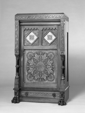 Daniel Pabst (American, born Germany, 1826-1910). Cabinet, ca. 1875. Walnut and burl ash, painted glass, 57 1/2 x 33 x 17in. (146.1 x 83.8 x 43.2cm). Brooklyn Museum, Bequest of Marie Bernice Bitzer, by exchange, 1990.9. Creative Commons-BY
