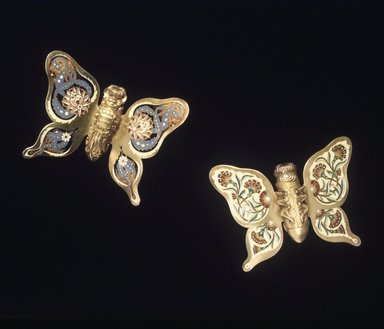 Charles T. Grosjean (died 1888). Napkin Clip, 1 of 2, 1878-1879. Gilt silver and enamel, 2 1/2 x 3 1/4 x 3/4 in. (6.4 x 8.3 x 1.9 cm). Brooklyn Museum, Gift of the American Art Council, 1991.101.1. Creative Commons-BY