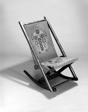 George Jacob Hunzinger (American, born Germany, 1835-1898). Folding Rocking Chair, ca. 1870. Walnut, brass, original upholstery, 31 3/4 x 17 7/8 x 29in. (80.6 x 45.4 x 73.7cm). Brooklyn Museum, George C. Brackett Fund, 1991.102. Creative Commons-BY