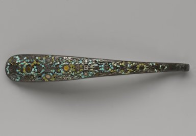 Garment Hook, 475-221 B.C.E. Bronze, inlaid with turquoise, silver, and gold, 7 1/8 x 1 in. (18.1 x 2.5 cm). Brooklyn Museum, Gift of Alan and Simone Hartman, 1991.127.6. Creative Commons-BY