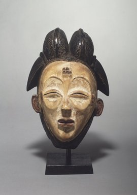 Punu. Mask (Okuyi), late 19th-early 20th century. Wood, pigment, 11 1/2 x 8 9/16 x 7 3/8 in. (29.2 x 21.7 x 18.7 cm). Brooklyn Museum, Gift of Corice and Armand P. Arman, 1991.169.2. Creative Commons-BY