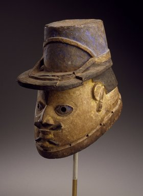 Yoruba. Gelede Helmet Mask of a Gendarme, early 20th century. Wood, metal, pigment, 10 x 7 x 11 in. (25.4 x 17.8 x 27.9 cm). Brooklyn Museum, Gift of Eugene and Harriet Becker, 1991.226.3. Creative Commons-BY