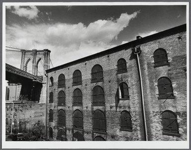 Tony Velez (American, born 1946). Brooklyn Bridge and Empire Stores (Warehouse), Brooklyn, NY., 1990. Gelatin silver photograph, Image: 10 x 13 1/2 in. (25.4 x 34.3 cm). Brooklyn Museum, Gift of Paul Velez, 1991.308.14. © Tony Velez