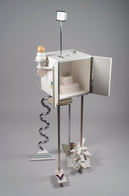 "Peter Shire (American, born 1947). ""Ode to a Soapstone Monkey"" Cabinet-on-Stand, 1988. SURREL (TM) solid surfacing material, Colorcore (TM), metal, porcelain, fluorescent bulb, Overall: 69 7/8 x 31 1/2 x 30 in. (177.5 x 80 x 76.2 cm). Brooklyn Museum, Gift of Formica Corporation, 1991.6.1a-d. Creative Commons-BY"