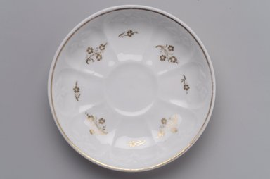 Charles Cartlidge & Co. (1848-1856). Saucer, ca. 1850. Porcelain, gilt, 1 x 5 11/16 x 5 11/16 in. (2.5 x 14.4 x 14.4 cm). Brooklyn Museum, Gift of George West, 1991.98. Creative Commons-BY