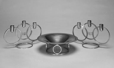 "Walter Dorwin Teague (American, 1883-1960). Candelabrum, One of Pair, ""Classique Modern,"" Introduced 1934. Pewter, 6 9/16 x 10 1/8 x 4 5/16 in.  (16.7 x 25.7 x 11.0 cm). Brooklyn Museum, Marie Bernice Bitzer Fund, 1993.78.3. Creative Commons-BY"
