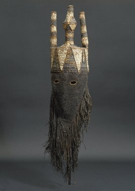 Salampasu. Mask for the Idangani Society, Akish, early 20th century. Cloth, pigment, wicker, fiber, 31 1/2 x 8 1/16 x 7 1/16 in. (80 x 20.4 x 18 cm). Brooklyn Museum, Gift of Corice and Armand P. Arman, 1992.133.1. Creative Commons-BY