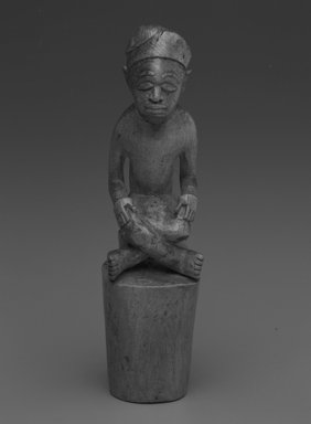 Kongo. Male Figure with Crossed Legs, early 20th century. Wood, 5 3/4 x 1 1/8 x 1 1/2in. (14.6 x 2.9 x 3.8cm). Brooklyn Museum, Gift of Drs. Noble and Jean Endicott, 1992.136.16. Creative Commons-BY