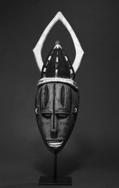 Urhobo. Mask, 20th century. Wood, pigment, beads, 19 3/4 x 6 x 4 3/4 in. (50.2 x 15.2 x 12.1 cm). Brooklyn Museum, Gift of Lee Lorenz, 1992.138.1. Creative Commons-BY
