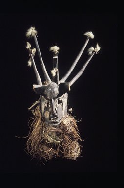 Manding. Men's Society Mask, 19th-20th centuries. Wood, metal, cowrie shells, mirror, fur, cord, fiber, cloth, feather fragments, height including  cloth, feathers and fragments:. Brooklyn Museum, Gift of Blake Robinson, 1992.26.6. Creative Commons-BY