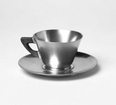 Marion Anderson Noyes (American, 1907-2002). Cup and Saucer, 20th century. Pewter, walnut, (a) Cup: 1 7/8 x 3 1/4 x 2 9/16 x 2 9/16 in. (4.8 x 8.3 x 6.5 x 6.5 cm). Brooklyn Museum, Gift of Marion Anderson Noyes, 1992.40.13a-b. Creative Commons-BY