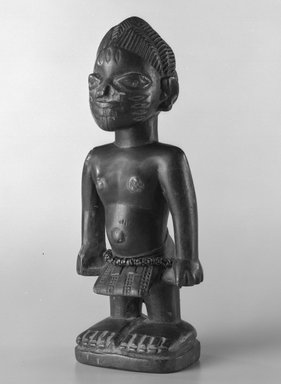 Yoruba. Standing Male Figure (Ere Ibeji), early 20th century. Wood, glass beads, nails, 8 x 2 1/2in. (20.3 x 6.4cm). Brooklyn Museum, Gift of the David and Margery Edwards Collection, 1992.67.2. Creative Commons-BY