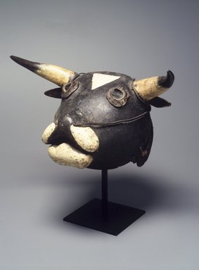 Bijagó. Ox Mask (Dugn'be), 20th century. Wood, raffia, bone, glass, metal, fur, paint, fiber, 15 1/2 x 19 x 9in. (39.4 x 48.3 x 22.9cm). Brooklyn Museum, Gift of Mr. and Mrs. Joseph Gerofsky, 1992.69.3. Creative Commons-BY