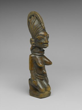Yoruba. Kneeling Female Figure, late 19th or early 20th century. Wood, 8 1/2 x 2 x 2 1/2 in. (21.6 x 5.1 x 6.4 cm). Brooklyn Museum, Gift of Mr. and Mrs. Joseph Gerofsky in honor of Ruth Lippman, 1992.70. Creative Commons-BY