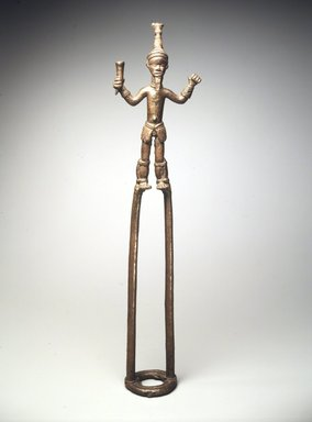Duahn Yibay (Dan, flourished 1920s-1930s). Figure of a Dancer, late 19th or early 20th century. Copper alloy, 20 1/2 x 5 1/4 x 1 3/8 in.  (52.1 x 13.3 x 3.5 cm). Brooklyn Museum, Gift of Harry S. Glaze, 1992.71.2. Creative Commons-BY