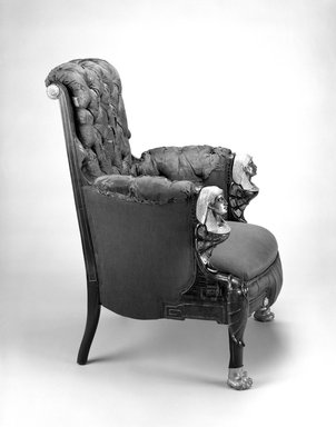 Pottier & Stymus. Armchair (Egyptian Revival style), ca. 1870. Rosewood, burl walnut, gilt and patinated metal mounts, original upholstery, 38 1/4 x 30 x 29 in.  (97.2 x 76.2 x 73.7 cm). Brooklyn Museum, Bequest of Marie Bernice Bitzer, by exchange and anonymous gift, 1992.89. Creative Commons-BY