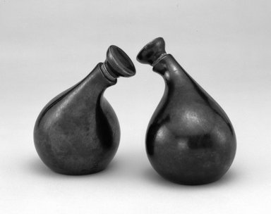 """Eva Zeisel (American, born Hungary, 1906-2011). Cruet and Stopper, """"Town and Country"""" Pattern, ca. 1942-1943. Earthenware, cork, 5 5/8 x 5 x 3 1/2 in.  (14.3 x 12.7 x 8.9 cm). Brooklyn Museum, Gift of Paul F. Walter , 1992.98.9a-b. Creative Commons-BY"""