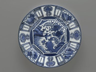 Arita Blue and White Charger, ca. 1680. Porcelain, blue underglaze, in Wan Li style, 3 x 18 1/8 in. (7.6 x 46 cm). Brooklyn Museum, Gift of Dr. Bertram H. Schaffner, 1993.106.10. Creative Commons-BY