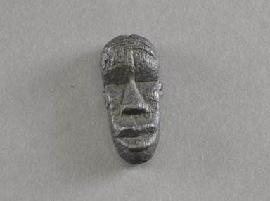 Bassa. Personal Miniature Mask, 20th century. Wood, 2 3/8 x 1 1/16 in. (6 x 2.7 cm). Brooklyn Museum, Gift of Dr. Svend E. Holsoe, 1993.175.9. Creative Commons-BY