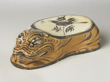 Cizhou Ware Pillow in the Form of a Tiger, 1182. Cizhou ware, earthenware, painted slip decoration with transparent glaze, 4 3/8 x 6 3/4 x 14 1/2 in. (11.1 x 17.1 x 36.8 cm). Brooklyn Museum, Gift of the Asian Art Council, 1993.56. Creative Commons-BY
